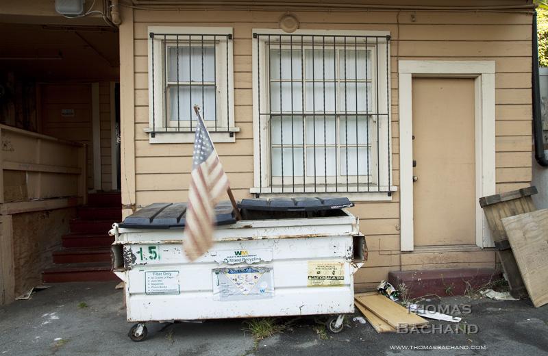 Flag in dumpster.  Oakland, California CA.