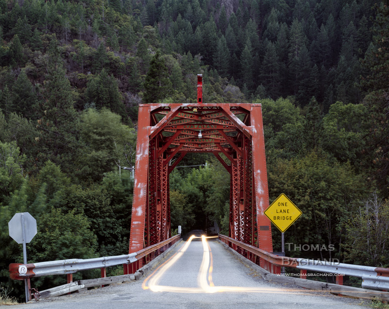 Rural red steel bridge.California.